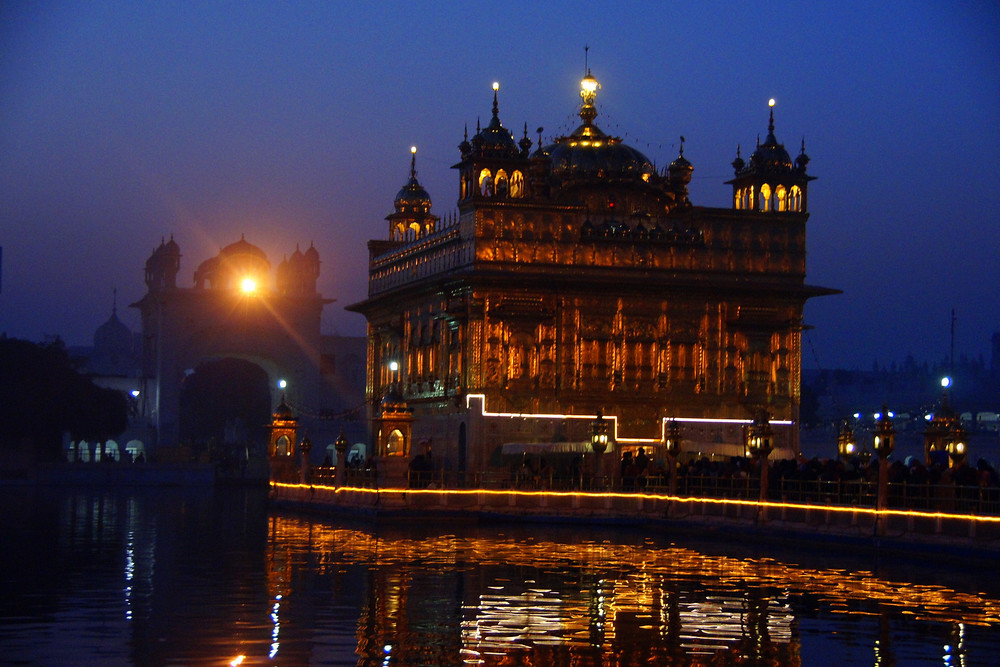 The Harmandir Sahib (Golden Temple) illuminated at night in Amritsar, India