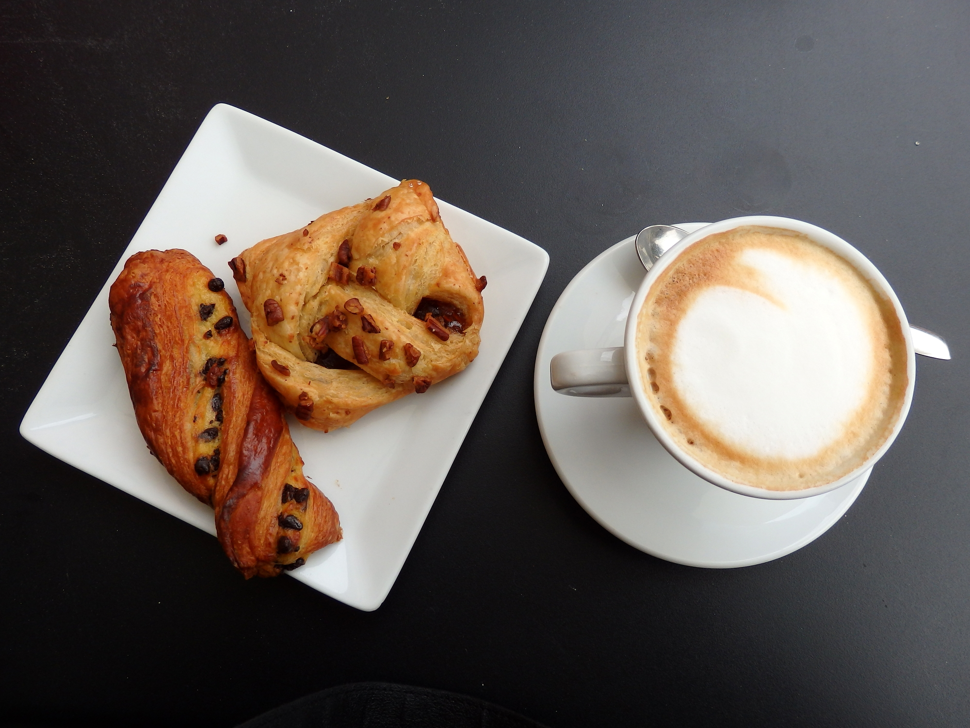 Italian breakfast including cappuccino and pastries in Milan, Italy