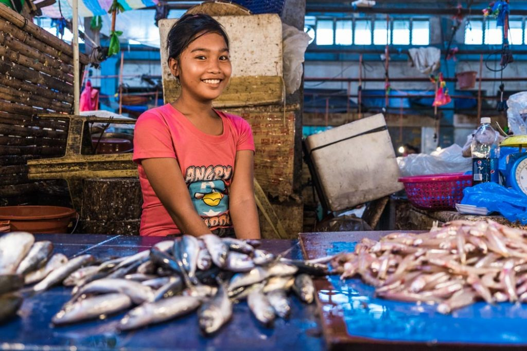 The more remote places in the world you visit, the more beautiful girls you meet. Kaylen, a 14-year-old girl in Roxas, Philippines looking shyly at her father trying to seek his approval to pose for me.