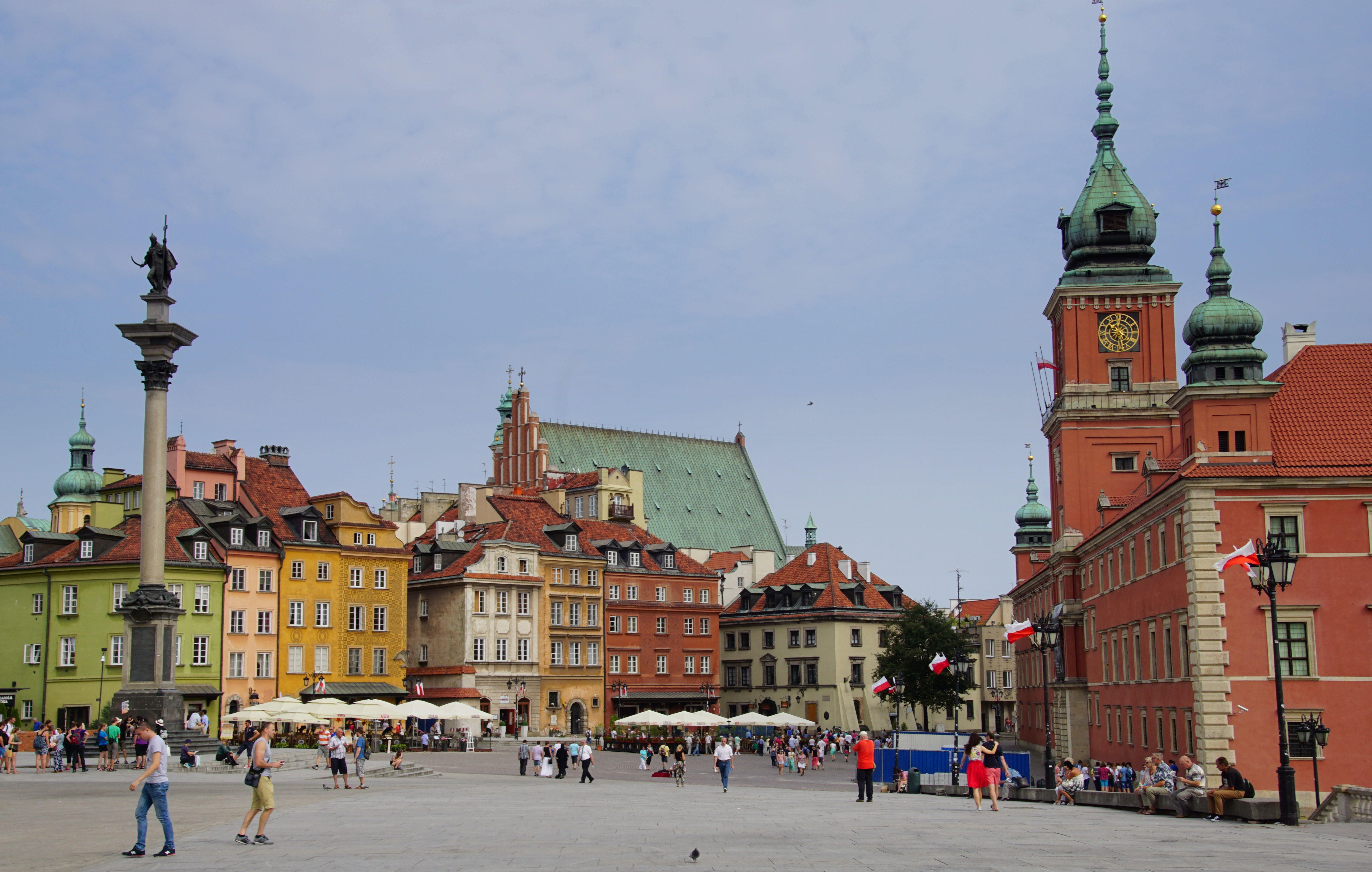 Castle Square with pedestrians and tourists walking in Warsaw, Poland - plac Zamkowy