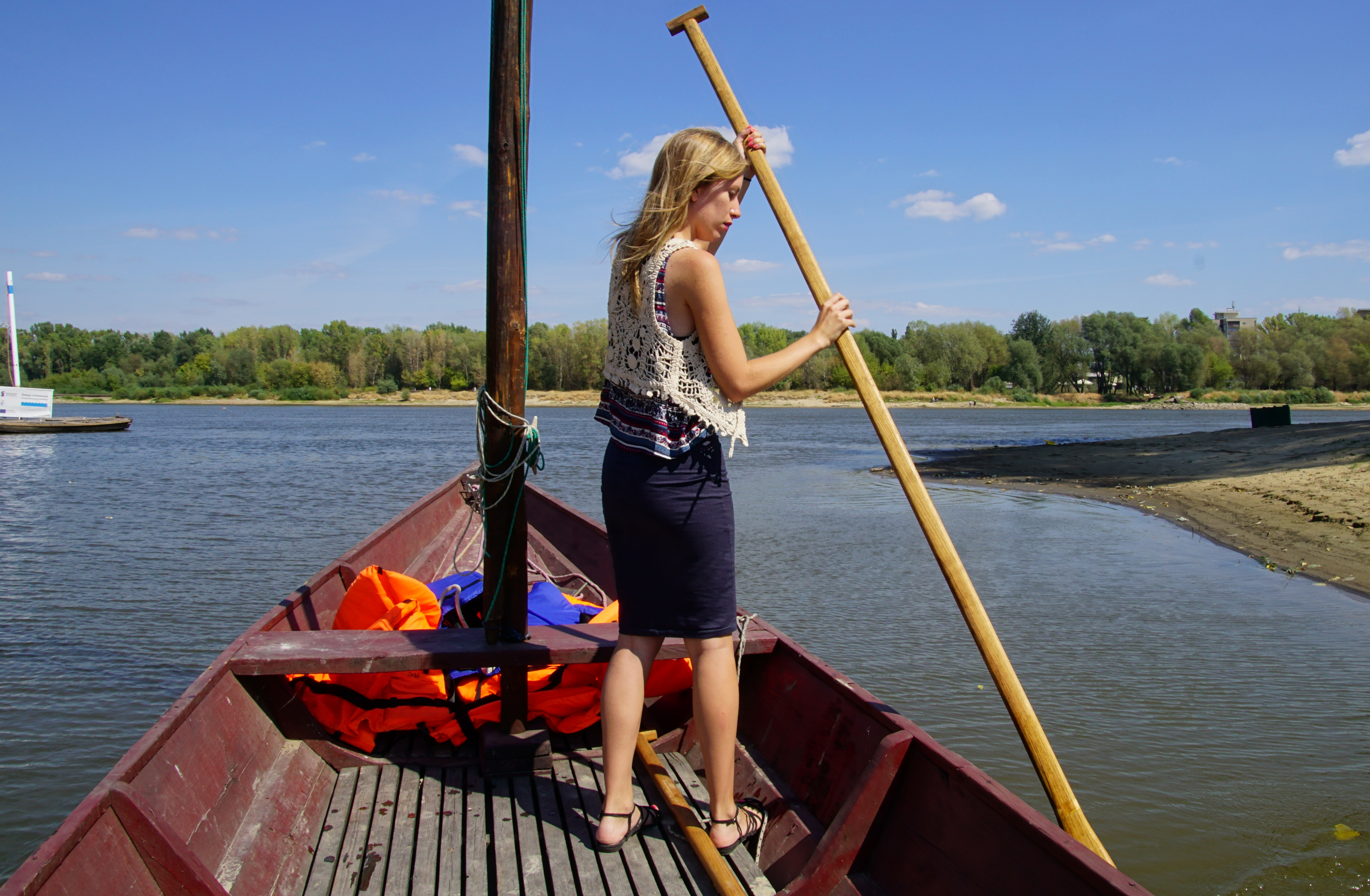 That Backacker Audrey Bergner paddling on a boat in Warsaw, Poland