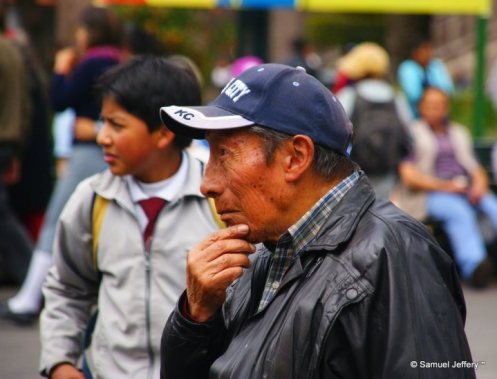 Man pondering and thinking in Quito, Ecuador candid portrait