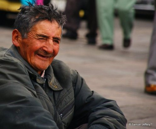 Smiling man on the streets of Quito, Ecuador candid portrait